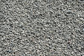 Gray pea gravel used to improve drainage for an egress well