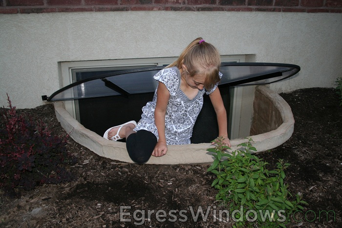 Brick basement window wells Stone Beach House Design Finish Basement Apartment Safely With Egress Window Wells